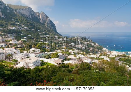 Capri island Italy. Capri is an island located in the Tyrrhenian Sea off the Sorrentine Peninsula, on the south side of the Gulf of Naples in the Campania region of Italy.