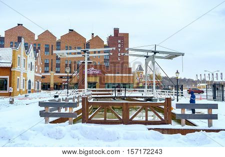 KIEV UKRAINE - NOVEMBER 11 2016: The shopping city built in Dutch Revival Style with canals wooden drawbridge and brick buildings on November 11 in Kiev.