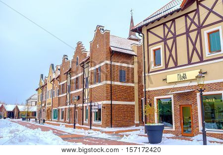 KIEV UKRAINE - NOVEMBER 11 2016: The stepped gable houses in Dutch Revival style shopping neighborhood serves as fashion stores cafes and art galleries on November 11 in Kiev.