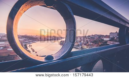 Dom Luis I Bridge over the river Douro in Porto Portugal. The bridge was constructed according to Eifel's project and has a train track runs over it