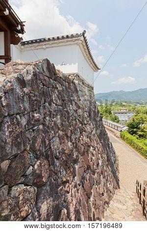 FUKUCHIYAMA JAPAN - JULY 29 2016: Stone walls (Ishigaki) of Fukuchiyama castle. Castle was erected in 1579 by Akechi Mitsuhide abandoned in 19th c. reconstructed in 1985