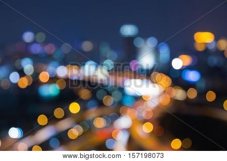 Blurred bokeh lights nights city and highway interchanged