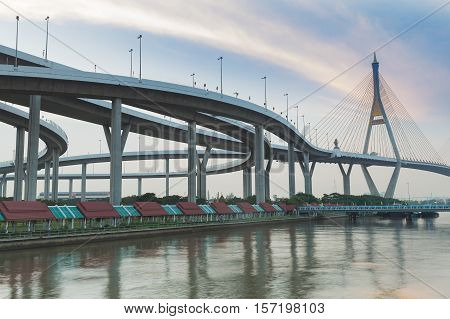 Suspension Bridge connect to highway interchanged with blue sky background, Bangkok Thailand