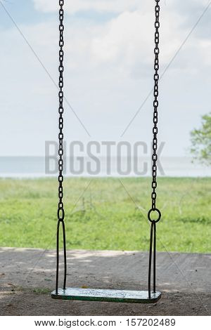 Close up Empty chain swing in playground