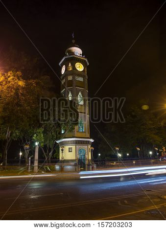 Clock tower in downtown Guayaquil, on the boardwalk, at night.