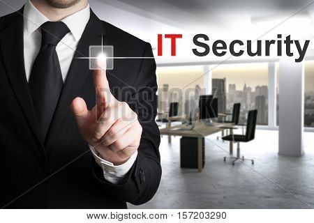 businessman in office pushing button it security