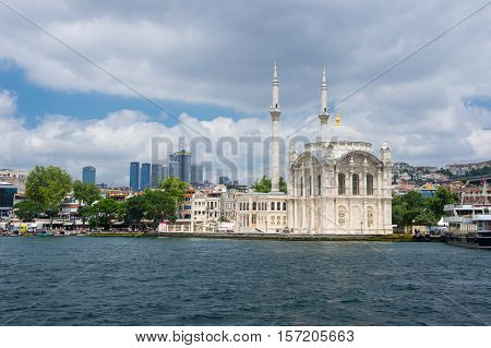 ISTANBUL TURKEY - JUNE 25 2015: Ortaköy Mosque (Grand Imperial Mosque of Sultan Abdulmecid) in Istanbul Turkey is situated at the waterside of the Ortakoy pier square one of the most popular locations on the Bosphorus