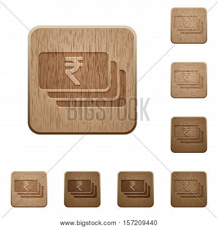 Indian Rupee banknotes icons in carved wooden button styles