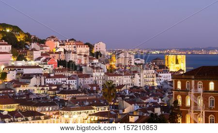Cityscape of Lisbon Portugal seen from Miradouro Sao Pedro de Alcantara at night