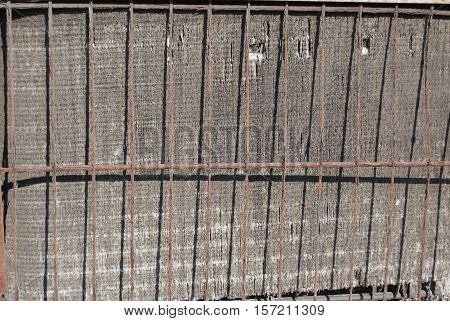 Aging, dinged up air conditioning radiator grill.