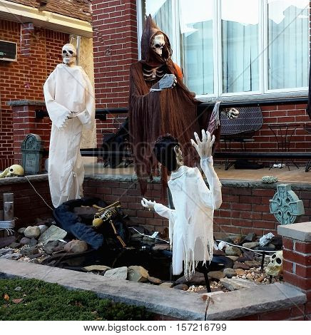 Halloween yard decorations ghosts and skeletons. Decoration for the holiday