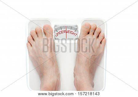 Feet On Mechanical Bathroom Scale Isolated On White