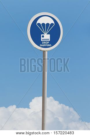 Blue drop shipping street sign in cloudy day
