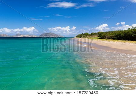 Standing in the sea off St Nevis looking towards St Kitts in the Caribbean