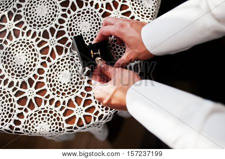 Man Takes Luxury Cufflinks From Box. Gathering Of Groom On Wedding Day.