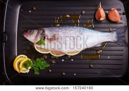 Sea bass with parsley and lemon, ready for cooking