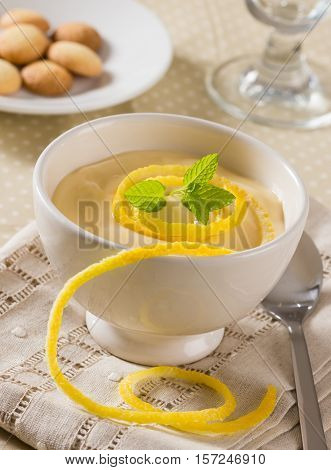 Lemon curd served with lemon peel and mint