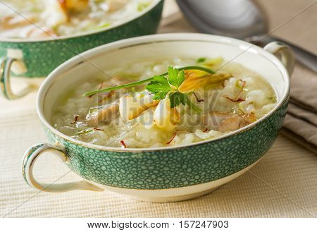 A bowl of rice soup with fresh garlic saffron and ginger.