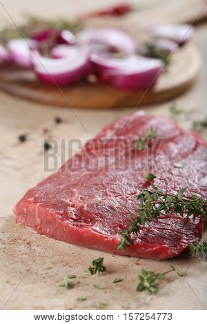 The piece of fresh beef lies on a table-top