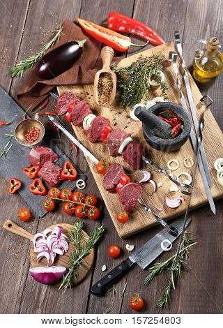 Shish kebab cooking from beef sirloin, on a table