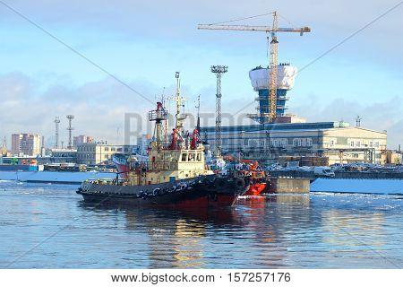 SAINT PETERSBURG, RUSSIA - FEBRUARY 17, 2016: The harbor tug
