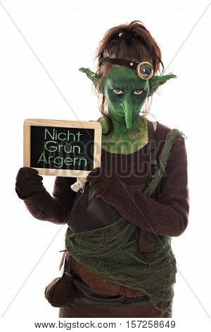 Green Goblin Holding A Slate With German Text, Not To Be Extremely Angry