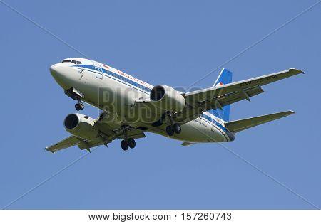 SAINT PETERSBURG, RUSSIA - JUNE 29, 2015: Aircraft Boeing 737-500 (EW-253PA) before landing at the airport Pulkovo