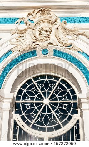 TSARSKOYE SELO, SAINT - PETERSBURG, RUSSIA - OCTOBER 19, 2016: Mask of Neptune on the keystone of the window of The Grotto Pavilion on the bank of The Great Pond in The Catherine Park