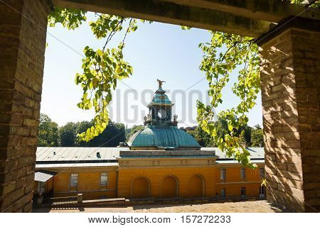 View of the New Chambers Palace in a frame Sanssouci park