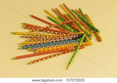 Office supplies; school supplies; illustration; colorful pencils; portrait door; study object