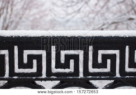 Metalic bar pattern pod with snow in winter
