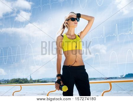 Young, beautiful, sporty and fit girl over imaginary digital background