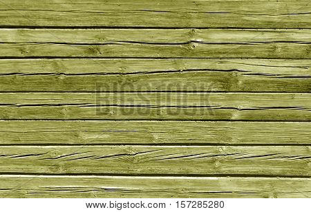 Weathered Yellow Color Log House Wall.