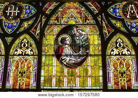 Kokomo - Circa November 2016: Church Stained Glass Portraying Cherubs and Saint Cecilia the Patron Saint or Patroness of Musicians II