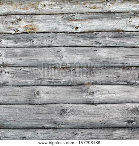 Old Hewn Natural Log Cabin Or Barn Wall Frame Texture. Rustic Vintage Log Wall Square Background. Fragment Of Rural House Wall From Unpainted Wooden Debarked Logs