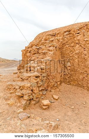 Disused old buildings wall at the foot of the Tower of Silence in Yazd, Iran.