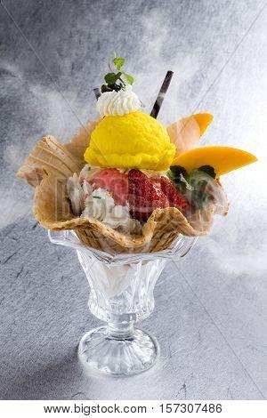 Strawberry and manago ice cream sundae on white background