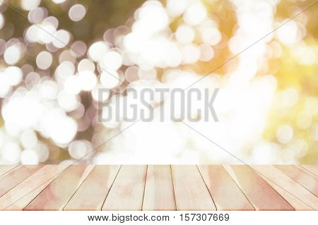 wooden floor on green bokeh background.Wooden desk on green bokeh background. Defocused green nature background.Colorful bokeh abstract background.