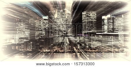 London, UK - October 20, 2011: Canary Wharf in London's Docklands on the Isle of Dogs at night with a lens zoom burst, showing Citi Bank, Nat West Bank and Barclays Bank skyscraper towers