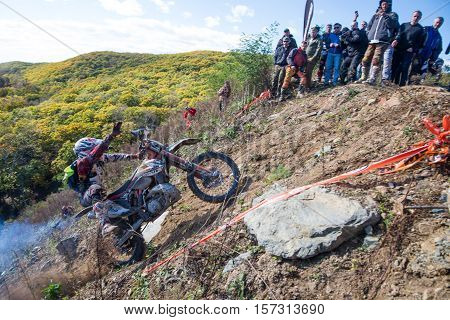 VLADIVOSTOK, RUSSIA - OCTOBER 10: competition On the edge 2016 Hard Enduro Rally with a KTM motorcycle. The hardest enduro rally in the world. October 10, 2016 in Vladivostok, Russia