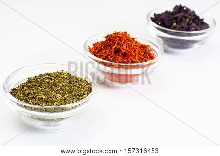 Basil, Saffron, Mint in a Glass Bowl on a White Background