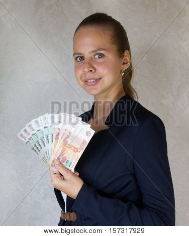 Girl with russian money in hand .