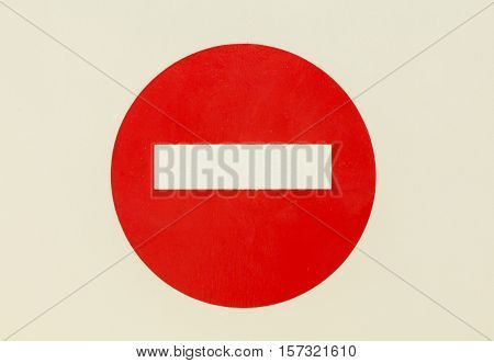 Round red road sign on white isolated door. No Entry road-sign mounted on perfect empty door