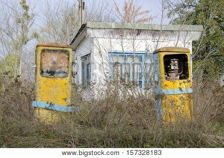 Abandoned gas station. Old gas pump. Broken gas pump