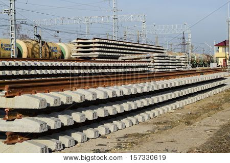 New Rails And Sleepers. The Rails And Sleepers Are Stacked On Each Other. Renovation Of The Railway.