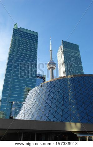 Downtown Toronto with the Roy Thomson hall the CN tower and two tall high rise buildings.