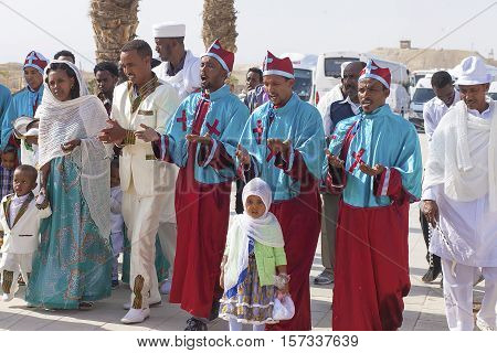 JERICHO, ISRAEL - NOV 12, 2016: Ethiopian pilgrim party in national clothes visiting Qasr el Yahud the Baptismal site on Jordan river.