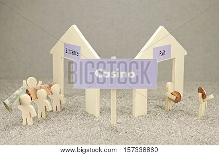 Loser in the casino - illustration with wooden figures