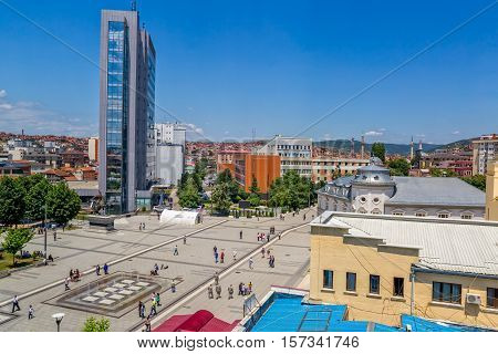 PRISTINA, KOSOVO - JULY 01, 2015: Scanderbeg square in city center with the government building, statue and the new fountain, view from hotel Swiss Diamond Prishtina.