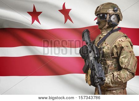 Soldier In Helmet Holding Machine Gun With Usa State Flag On Background Series - Columbia D.c.